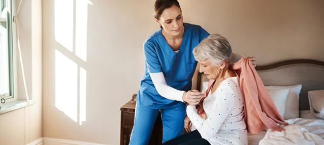 eldery-woman-caregiver-nursing-home-senior
